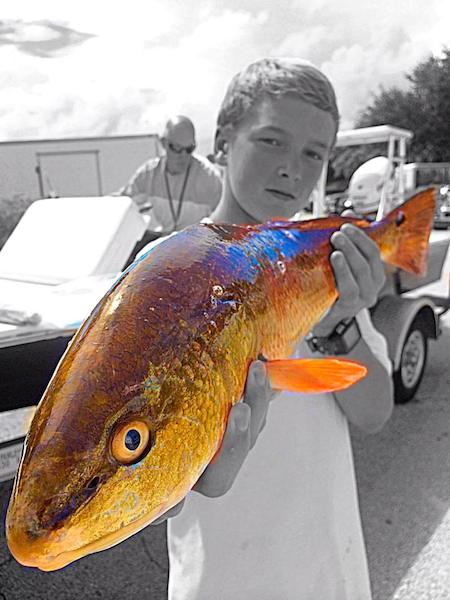 Dawson Porter, 2, caught this 26-inch redfish in New Smyrna Beach, FL / Headline Surfer®