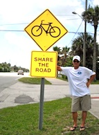Jake Sachs, candidate for a New Smyrna Beach commissioner seat stands on Third Aveveue, where he got speeds lowered / Headline Surfer®