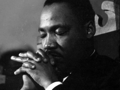 MLK in prayer / Headline Surfer®
