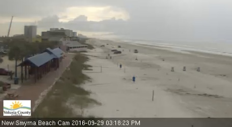 Beach cam off Flaglewr Avenue ramp in New Smyrna Beach, Florida, sdhows minimal beach visitors on this Thursday afternoon / Headline Surfer