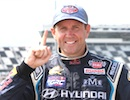 Rallycross driver Rhys Millen gives the No.1 signal after his win at Daytona / Headline Surfer®