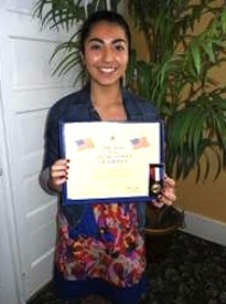 Vania Bustamante of Seabreeze HS in Ormond Beach received an award from the Daughters of the American Revolution / Headline Surfer®