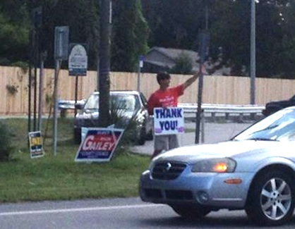 Rich Gailey waves to passersby on primary night in DeBary / Headline Surfer®