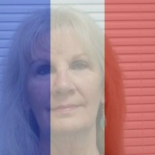 Geraldine Clinton of Oak Hill, Florida, displays French flag with her Facebook photo / Headline Surfer®