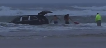 Third child rescued out back of mini van  after SC woman drives into Daytona surf / Headline Surfer®