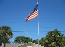 The American flag flies in front of Daytona Beach, FL resident Shirley Dacenzo's home on the 15th anniversary of 9/11 / Headline Surfer
