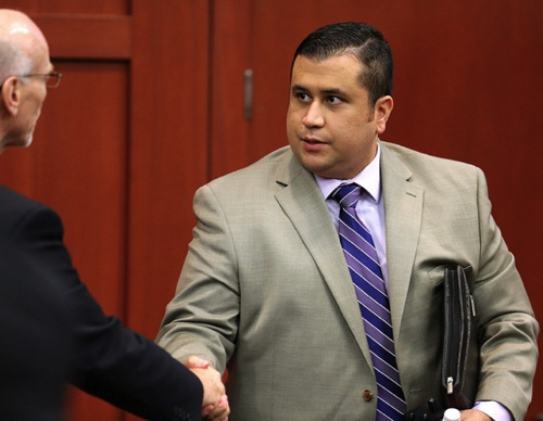 George Zimmerman shakes hands with co-defense counsel Don West / Headline Surfer
