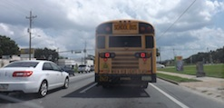 School bus travels south on US 1 In New Smyrna Beach / Headline Surfer