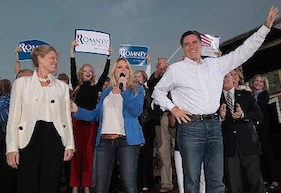Dana Swanson in the back holding Romney sign during Ormond visit / Headline Surfer