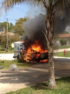 Postal truck catches fire in Edgewater, FL.