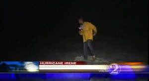 WESH reporter walking in the surf on Daytona Beach